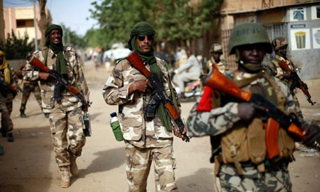 Soldiers from Chad patrol the recently liberated town of Gao in northern Mali